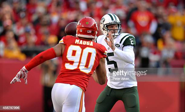 Matt Simms of the New York Jets passes against Josh Mauga of the Kansas City Chiefs during the second half at Arrowhead Stadium on November 2 2014 in...