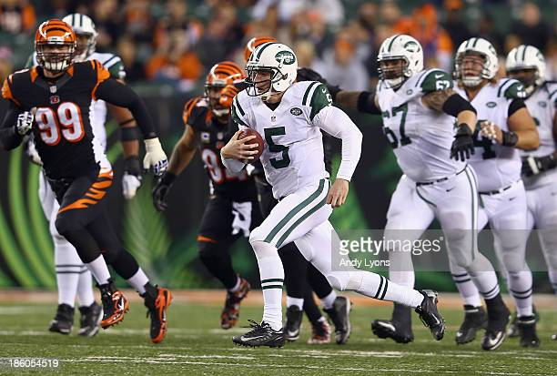 Matt Simms of the New York Jets runs with the ball during the NFL game against the Cincinnati Bengals at Paul Brown Stadium on October 27 2013 in...