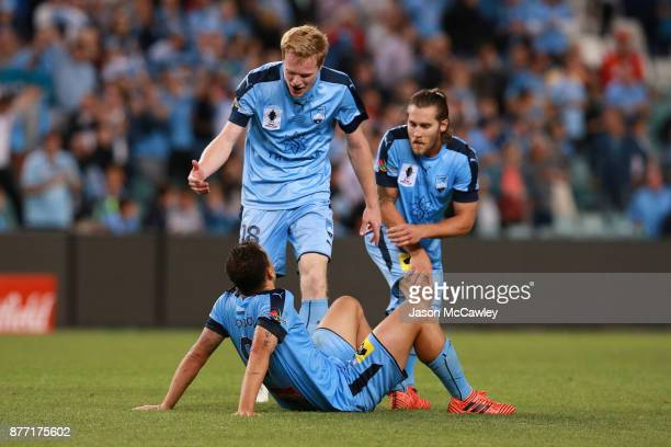 Matt Simon and Bobo of Sydney celebrate victory at the end of the FFA Cup Final match between Sydney FC and Adelaide United at Allianz Stadium on...