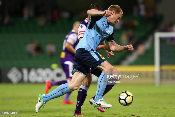 Matt Simon of Sydney controls the ball against Dino Djulbic of the Glory during the round 25 ALeague match between the Perth Glory and Sydney FC at...