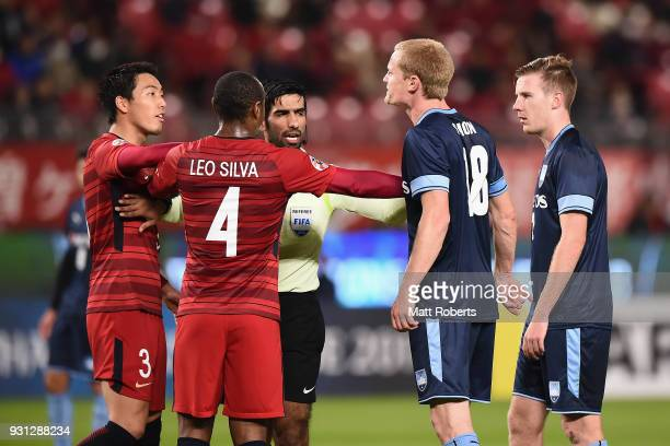 Matt Simon of Sydney FC and Gen Shoji of Kashima Antlers exchange words during the AFC Champions League Group H match between Kashima Antlers and...