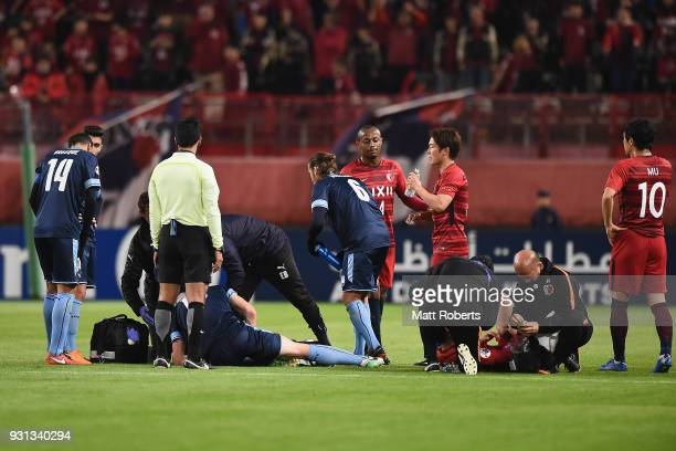 Matt Simon of Sydney FC and Gen Shoji of Kashima Antlers receive attention on the field during the AFC Champions League Group H match between Kashima...