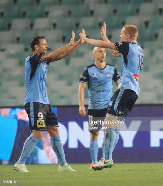 Matt Simon of Sydney FC celebrates a goal with Bobo during the round 26 ALeague match between Sydney FC and Adelaide United at Allianz Stadium on...