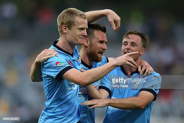 Matt Simon of Sydney FC celebrates with team mates after scoring a goal during the round four A-League match between the Central Coast Mariners and...