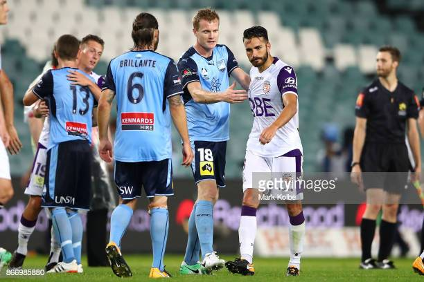 Matt Simon of Sydney FC tries to shakes hands with Rostyn Griffiths og the Glory as he walks away during the round four ALeague match between Sydney...