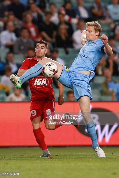 Matt Simon of Sydney is challenged by Ben Garuccio of Adelaide during the FFA Cup Final match between Sydney FC and Adelaide United at Allianz...