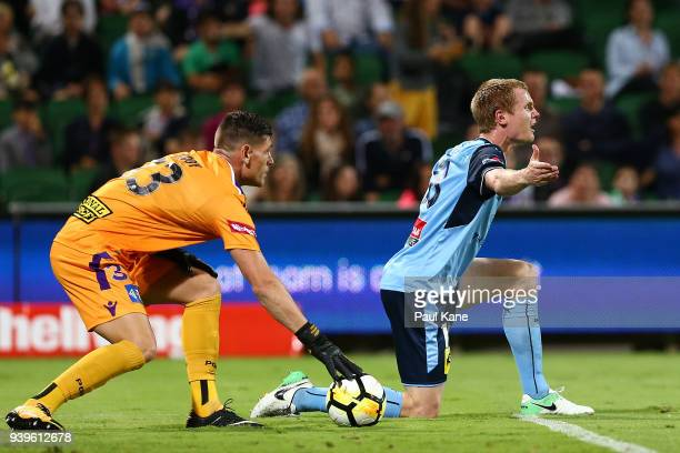 Matt Simon of Sydney pleads to Referee Kris GriffithsJones after being tackled by Dino Djulbic of the Glory during the round 25 ALeague match between...