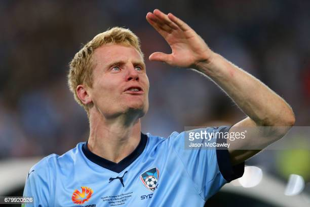 Matt Simon of Sydney reacts at full time after winning the 2017 ALeague Grand Final match between Sydney FC and the Melbourne Victory at Allianz...
