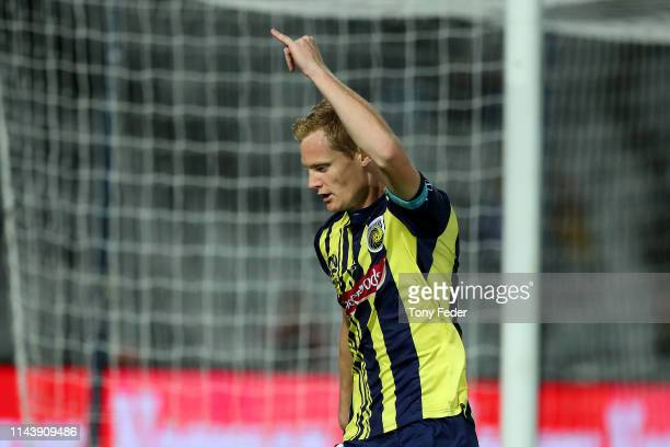 Matt Simon of the Central Coast Mariners celebrates a goal during the round 26 A-League match between the Central Coast Mariners and the Western...