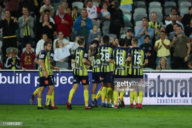Matt Simon of the Central Coast Mariners celebrates a goal with team mates during the round 26 ALeague match between the Central Coast Mariners and...