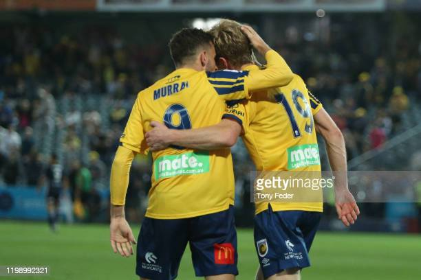 Matt Simon of the Central Coast Mariners celebrates a goal with team mate Jordan Murray during the round 14 A-League match between the Central Coast...