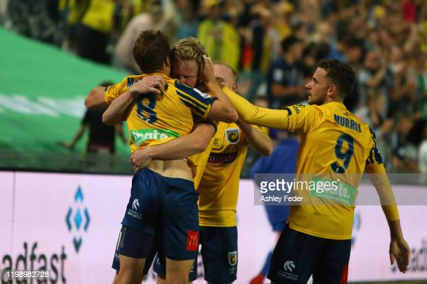 Matt Simon of the Central Coast Mariners celebrates his second goal during the round 14 ALeague match between the Central Coast Mariners and the...