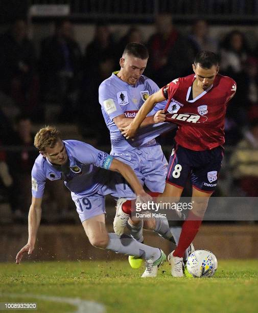 Matt Simon of the Mariners and Isa'as S‡nchez of United compete for the ball during the round of 32 FFA Cup match between Adelaide United and the...