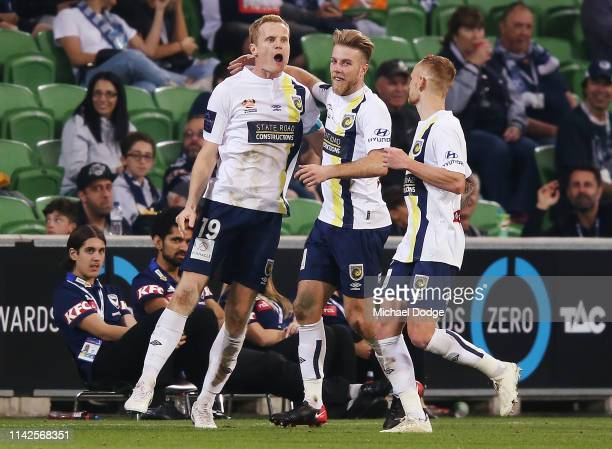 Matt Simon of the Mariners celebrates a goal during the round 25 ALeague match between Melbourne Victory and the Central Coast Mariners at AAMI Park...