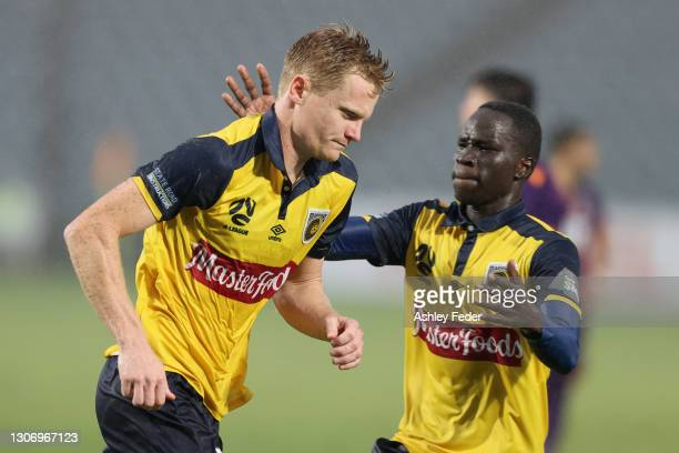 Matt Simon of the Mariners celebrates his goal from a penalty during the A-League match between the Central Coast Mariners and the Perth Glory at...