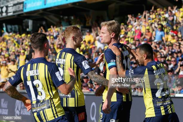 Matt Simon of the Mariners celebrates his goal with team mates during the round nine A-League match between the Central Coast Mariners and the...