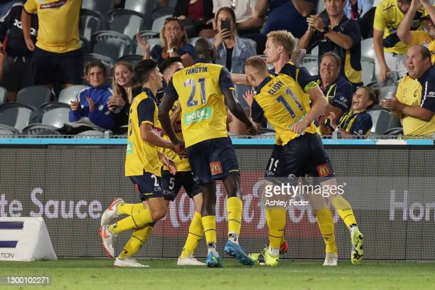 Matt Simon of the Mariners celebrates his goal with team mates during the A-League match between the Central Coast Mariners and Melbourne City FC at...