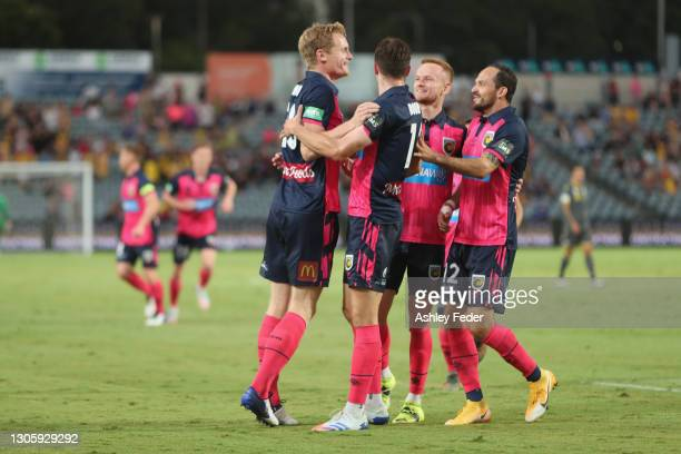 Matt Simon of the Mariners celebrates his goal with team mates during the A-League match between the Central Coast Mariners and Macarthur FC at...