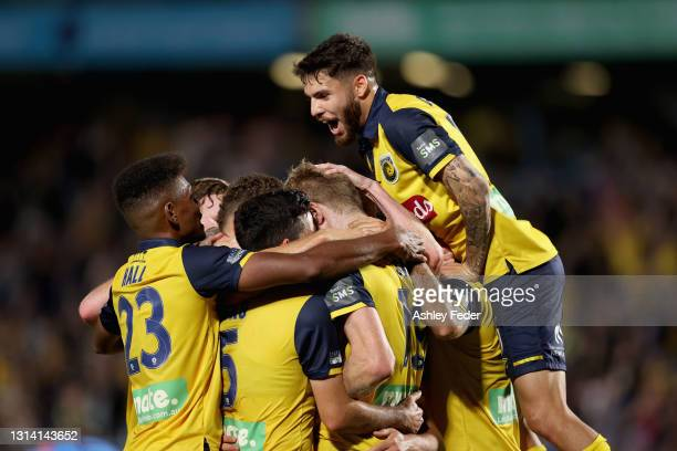 Matt Simon of the Marniers celebrates his goal with team mates during the A-League match between the Central Coast Mariners and Sydney FC at Central...