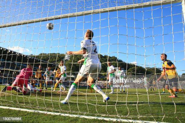 Matt Simon scores a goal for the Mariners during the round 7 A-League match between the Central Coast Mariners and Western United FC at Central Coast...