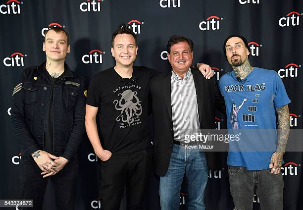 Matt Skiba Mark Hoppus Head of North America Branded Cards Citigroup Ralph Andretta and Travis Barker of Blink 182 pose before Backstage with Citi...