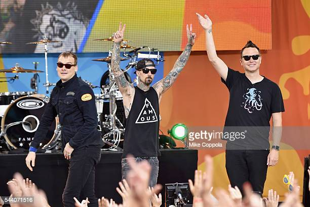 """Matt Skiba, Travis Barker, and Mark Hoppus of the band Blink 182 performs on ABC's """"Good Morning America"""" at SummerStage at Rumsey Playfield, Central..."""