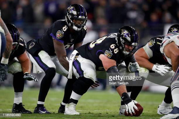Matt Skura prepares to snap the ball to Lamar Jackson of the Baltimore Ravens during the second half of the game against the New England Patriots at...