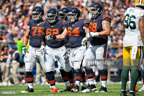 Matt Slauson Will Montgomery Vladimir Ducasse and Kyle Long of the Chicago Bears walks to the line of scrimmage during a game against the Green Bay...