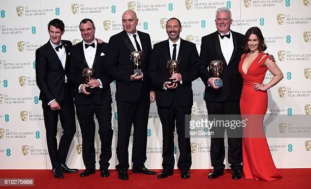 Matt Smith and Emilia Clarke pose with Chris Corbould Roger Guyett Paul Kavanagh and Neal Scanlan winners of the Visual Effects award for 'Star Wars...