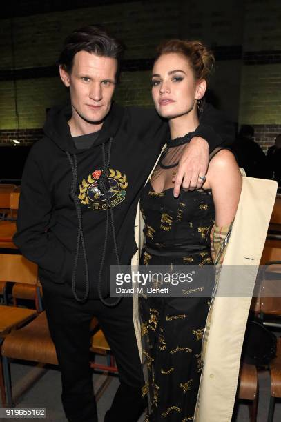 Matt Smith and Lily James wearing Burberry at the Burberry February 2018 show during London Fashion Week at Dimco Buildings on February 17 2018 in...