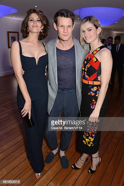 Matt Smith Lily James and Gemma Arterton attend the Vanity Fair And Armani Party at the 67th Annual Cannes Film Festival on May 17 2014 in Cap...