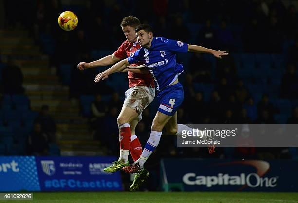 Matt Smith of Bristol City battles with John Egan of Gillingham during the Johnstone's Paint Southern Area Final first leg match between Gillingham...