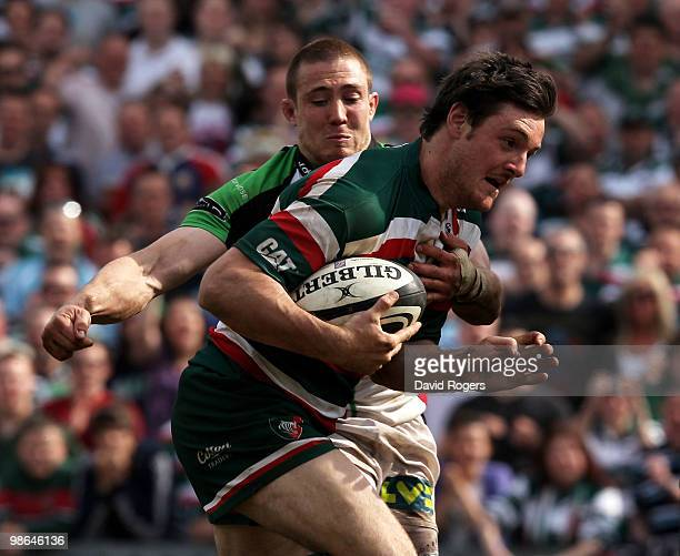 Matt Smith of Leicester breaks clear of Mike Brown to score a try during the Guinness Premiership match between Leicester Tigers and Harlequins at...