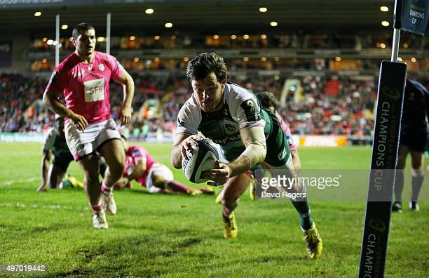 Matt Smith of Leicester dives to score a try during the Eurpean Rugby Champions Cup match between Leicester Tigers and Stade Francais at Welford Road...