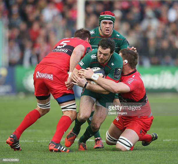 Matt Smith of Leicester is tackled by Ali Williams and Bakkies Botha during the European Rugby Champions Cup pool three match between RC Toulon and...