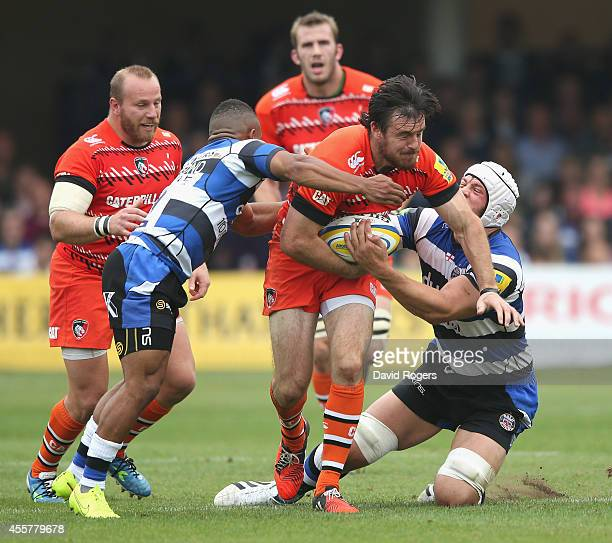Matt Smith of Leicester is tackled by Dave Attwood and Kyle Eastmond during the Aviva Premiership match between Bath and Leicester Tigers at the...