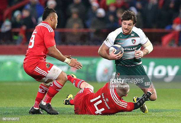 Matt Smith of Leicester is tackled by Keith Earls during the European Rugby Champions Cup match between Munster and Leicester Tigers at Thomond Park...