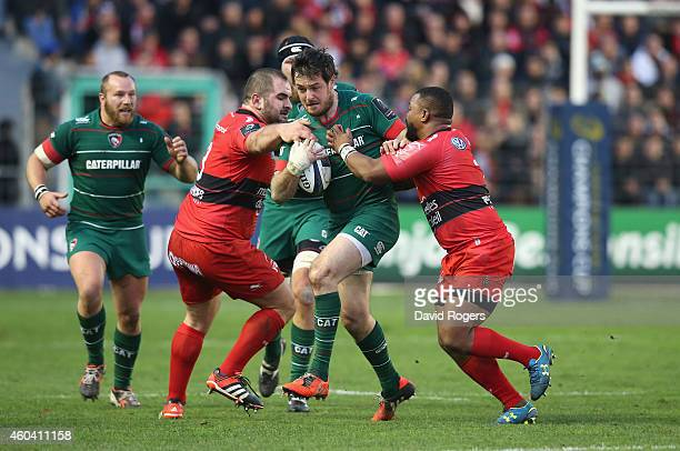 Matt Smith of Leicester is tackled by Steffon Armitage and Levan Chilachava during the European Rugby Champions Cup pool three match between RC...