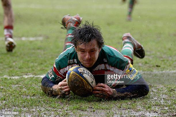 Matt Smith of Leicester Tigers breaks through to score a try during the Aviva Premiership match between Leicester Tigers and Gloucester at Welford...
