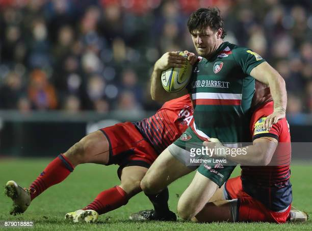 Matt Smith of Leicester Tigers is caught by the Worcester defence during the Aviva Premiership match between Leicester Tigers and Worcester Warriors...