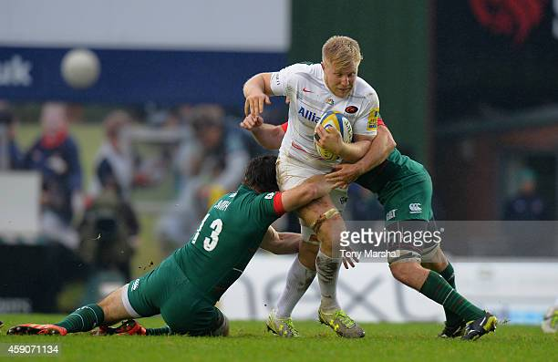 Matt Smith of Leicester Tigers tackles Jackson Wray of Saracens during the Aviva Premiership match between Leicester Tigers and Saracens at Welford...