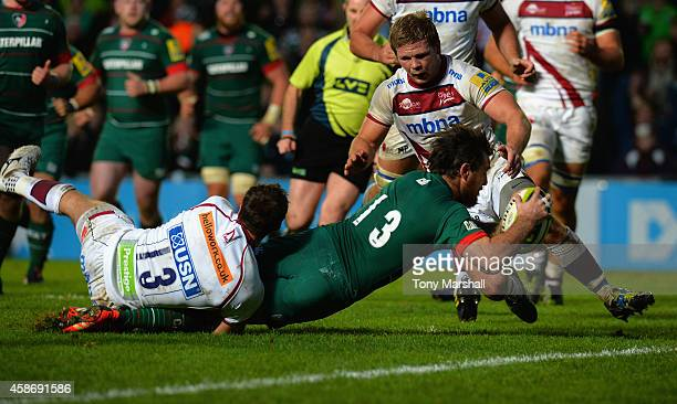 Matt Smith of Leicester Tigersdives in to score a try during the LV= Cup match between Leicester Tigers and Sale Sharks at Welford Road Stadium on...