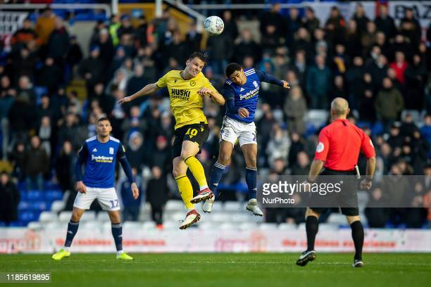 Matt Smith of Millwall challenging in the air with Jude Bellingham of Birmingham City during the Sky Bet Championship match between Birmingham City...