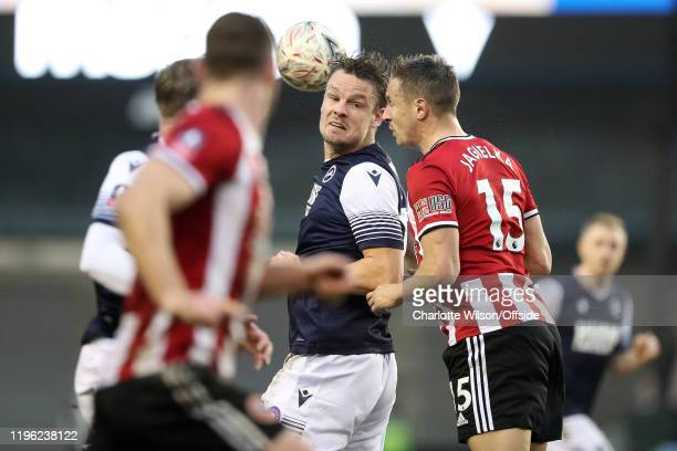 Matt Smith of Millwall looks round as Phil Jagielka of Sheffield United wins a header during the FA Cup Fourth Round match between Millwall and...