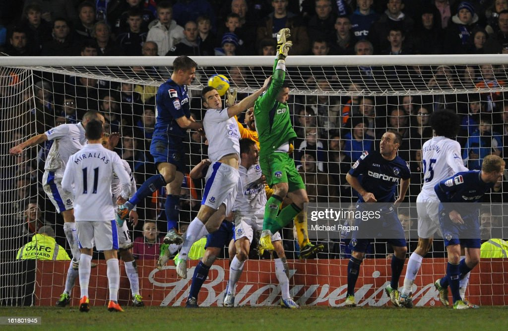 Matt Smith of Oldham Athletic scores his team's second goal to make the score 2-2 during the FA Cup with Budweiser Fifth Round match between Oldham Athletic and Everton at Boundary Park on February 16, 2013 in Oldham, England.