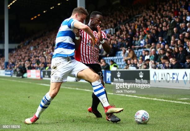 Matt Smith of QPR and Lamine Kone of Sunderland compete for the ball during the Sky Bet Championship match between Queens Park Rangers and Sunderland...