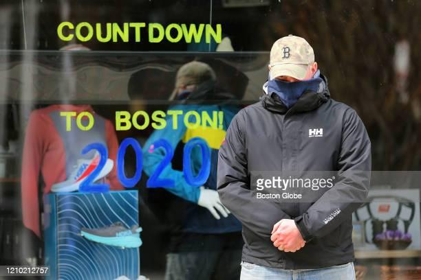 Matt Smith pauses in front of Marathon Sports near the finish line on Boylston St on One Boston Day the sevenyear anniversary of the Boston Marathon...