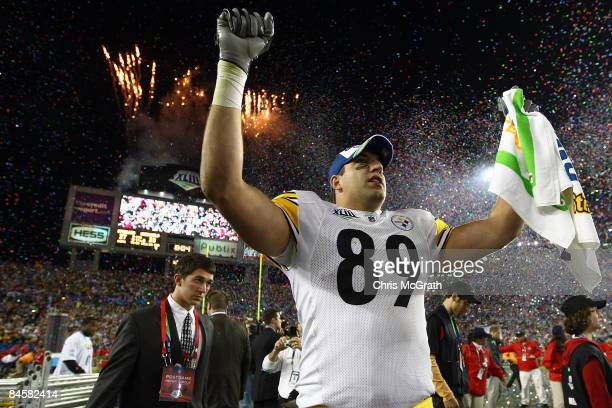 Matt Spaeth of the Pittsburgh Steelers celebrates on the field as confeti falls after the Steelers won 27-23 against the Arizona Cardinals during...