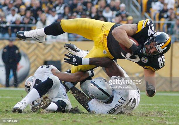 Matt Spaeth of the Pittsburgh Steelers is upended by the Oakland Raiders defense after catching a pass during the game on November 21 2010 at Heinz...
