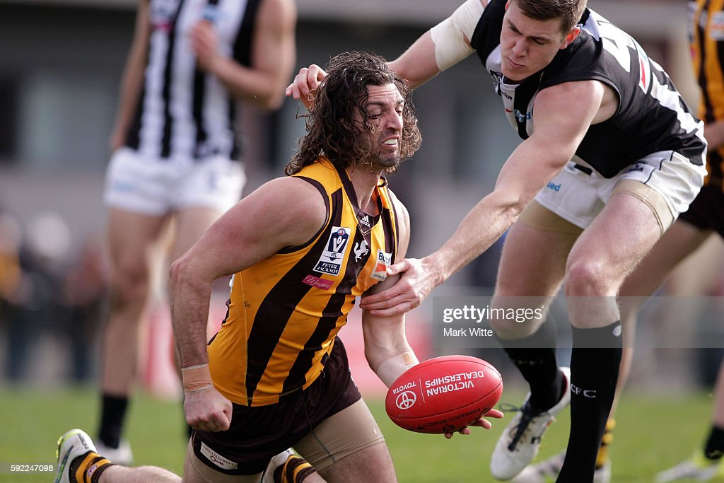 Matt Spanger handballs the ball during the round 20 VFL match between the Box Hill Hawks and the Collingwood Magpies at Box Hill City Oval on August 20, 2016 in Melbourne, Australia.